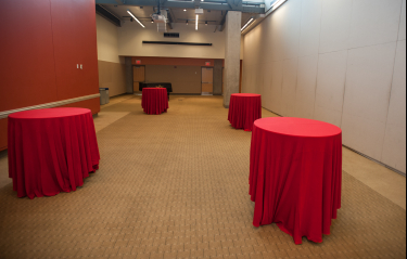 Pryz tables with red tableclothes